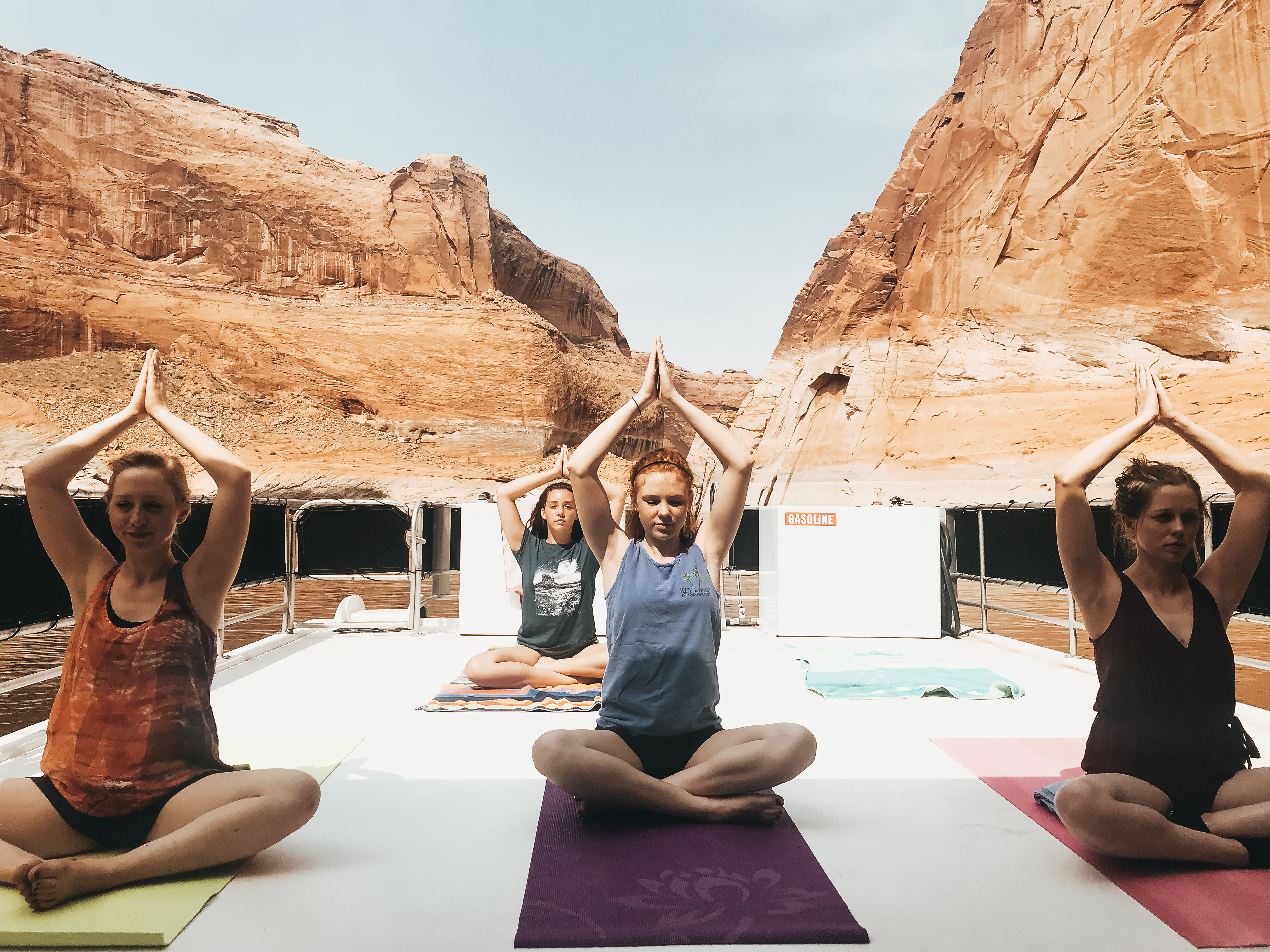 Yoga on top of a house boat